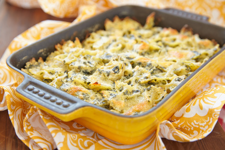 Baked farfalle pasta with spinach and artichoke