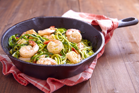 shrimp: Low carb zucchini spaghetti with shrimp in a pan Stock Photo