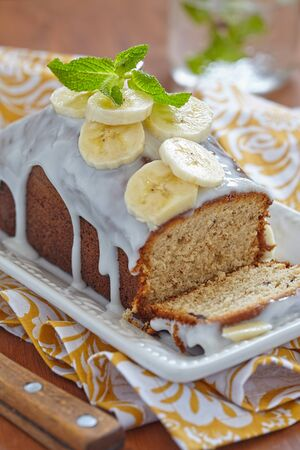 Banana bread with chocolate chips on wooden table photo