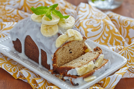 sliced bread: Banana bread with chocolate chips on wooden table