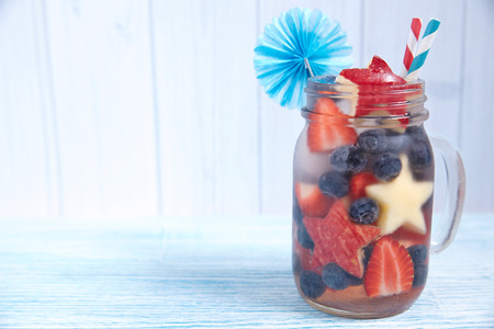 Patriotic drink cocktail with strawberry, blueberry and apple photo