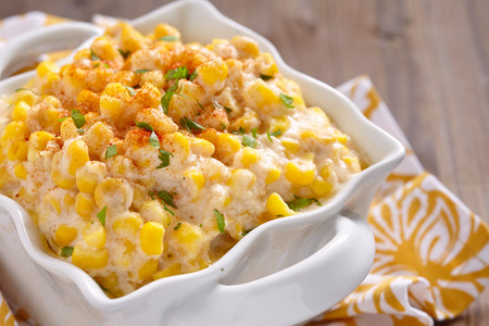 crock pot: Fresh creamy crock pot corn on a table Stock Photo