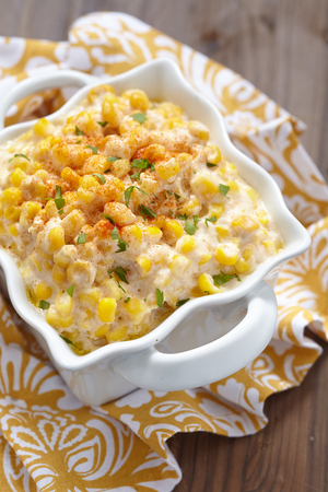 Fresh creamy crock pot corn on a table Stock Photo