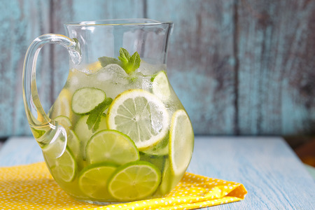 Fruit water with lemon, lime, cucumber and mint in glass pitcher 스톡 콘텐츠