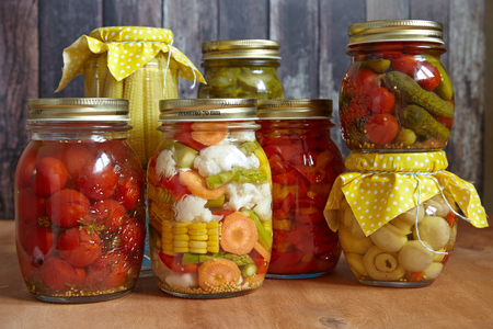 Assortment autumn preserves. Jars of pickled vegetables. Stock Photo