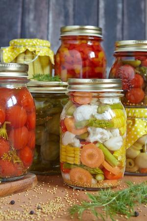 Assortment autumn preserves. Jars of pickled vegetables. photo