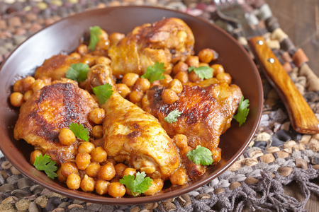 curry bowl: Curry Chicken With Chickpeas on a table
