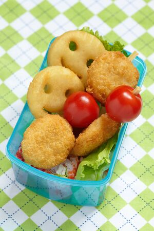 bento box: Bento box for children with chicken nuggets and potato pancakes