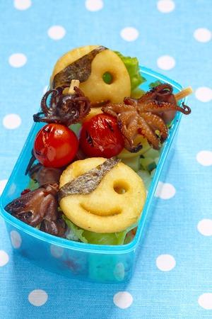 bento box: Pitates bento box for children with baby octopus and potato pancakes