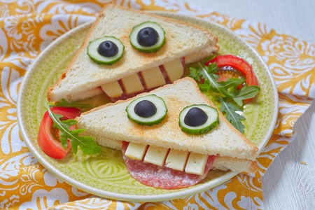 sandwich white background: Funny sandwich for kids lunch on a table