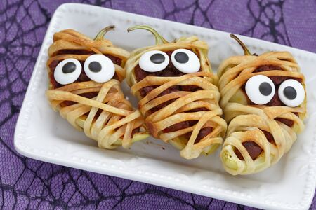Stuffed peppers look like a mummies for Halloween Stock Photo