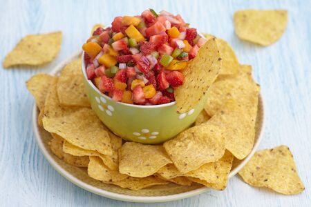 corn chips: Fresh strawberry mango salsa with corn chips
