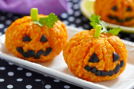Pumpkin Rice Ball Jack O Lanterns for Halloween party Stock Photo