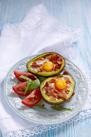 carb: Avocado Egg Boats with bacon. Low carb high fat breakfast Stock Photo