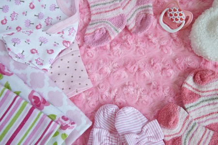 newborn baby mother: Pink layette for a newborn baby girl Stock Photo