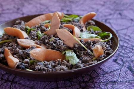 black beans: Mashed black beans and sausages for Halloween