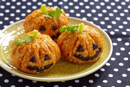 Pumpkin Rice Ball Jack O Lanterns for Halloween party Stock Photo