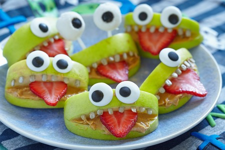 funny fruit: Spooky green apple monsters for Halloween party