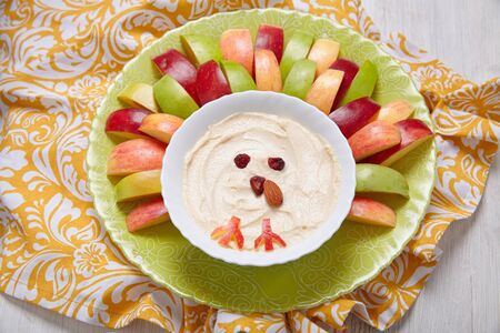 sliced: Apples with caramel cream cheese dip for Thanksgiving