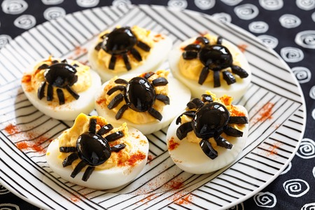 spider: Deviled eggs with a Spider for Halloween