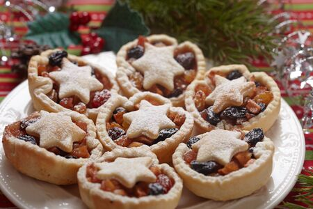 Christmas mince pies on a white plate