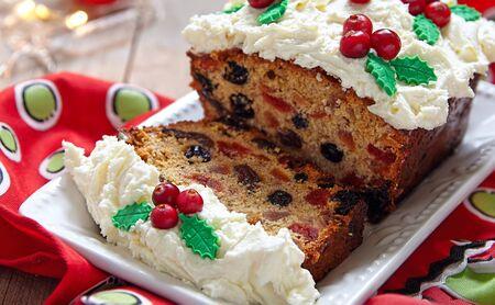 fruitcake: Traditional Christmas Fruitcake with Holly Berry Decoration Stock Photo