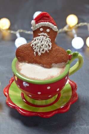 gingerbread cookie: Gingerbread Santa man cookie in a hot cup of cappuccino