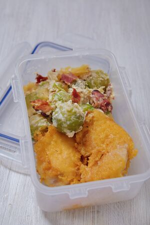 cheesy: Lunch box with brussel sprout casserole and fried cheesy chicken