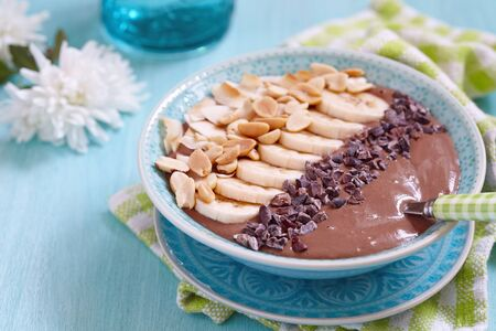 peanut: Peanut butter chocolate smoothie with banana and nuts topping