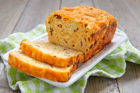 MEAT LOAF: Corn bread loaf with bacon and cheddar cheese Stock Photo