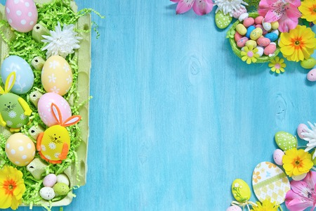 pink flowers: Easter decorations with colorful eggs, candies and flowers
