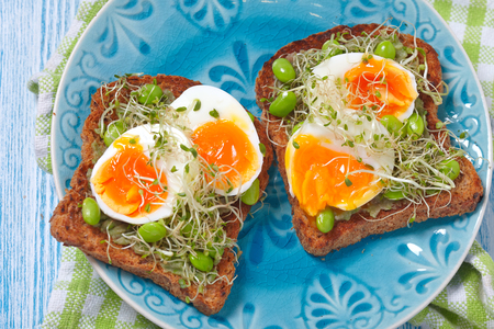wheat toast: Avocado and egg whole wheat toast with edamame