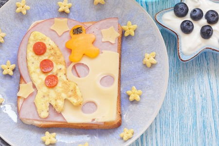 Funny sandwich with rocket and a astronaut on the cheese moon