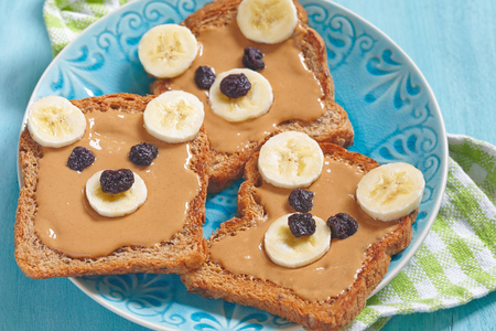 shape cub: Bear cubs made of whole wheat bread with peanut butter, banana and raisins