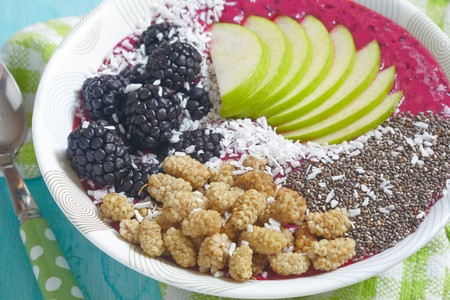 acai: Acai bowl smoothie topped with apples, berries, coconut and chia seeds