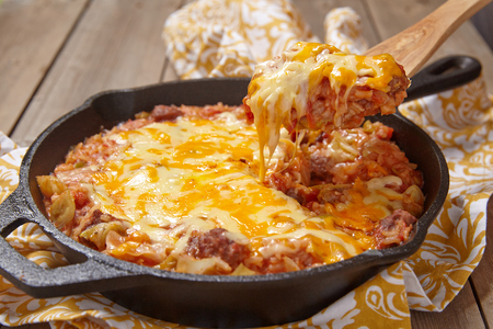 Cabbage casserole with beef, rice, cheese and tomato sauce