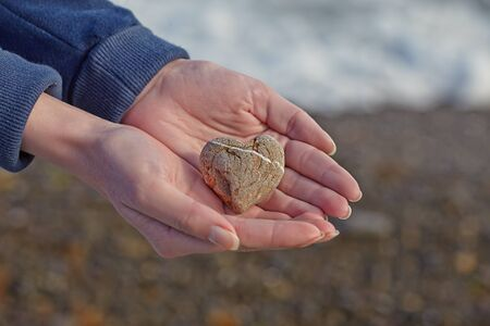 pebbles: Cute stone hearth in a womans hands