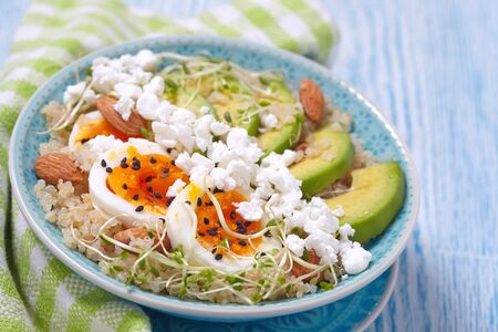 breakfast bowl: Quinoa bowl with egg and avocado for healthy breakfast
