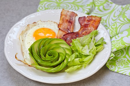 carb: Fried Egg, Bacon and Avocado Rose. Low carb high fat breakfast Stock Photo