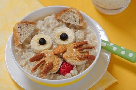 oatmeal: Oatmeal porridge with a kitten face decoration Stock Photo