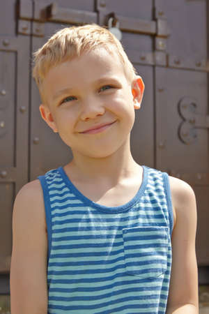 one boy only: Adorable boy portrait in the summer park
