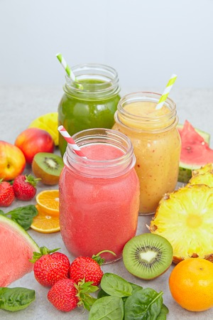 fruits juice: Smoothie jars surrounded by sliced fruits and berries