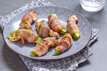 Roasted avocado pieces wrapped in bacon. Ketogenic diet