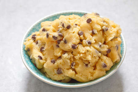 lactic: Sweet cookie dough with chocolate chips on a table Stock Photo