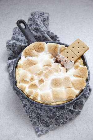 marshmellow: Smores dip baked in a cast iron pan with graham crackers