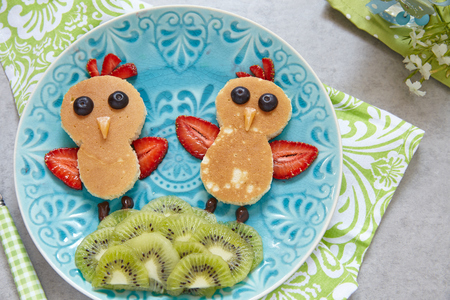 Funny chickens pancakes with berries for kids breakfast