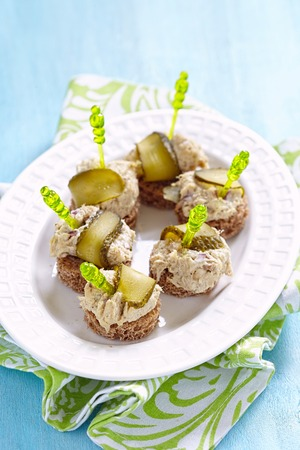 appetizers: Canapes with fish pate and pickle. Party food