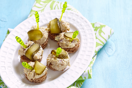 Canapes with fish pate and pickle. Party food