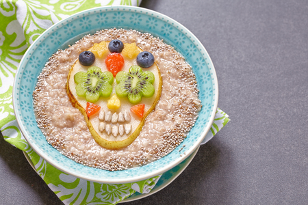 Fruity Sugar scull with oatmeal porridge for Halloween Stock Photo