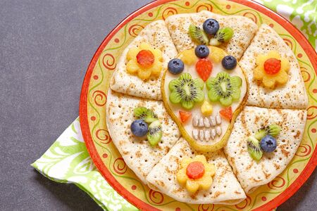 Fruity Sugar scull with crepes for Halloween Stock Photo